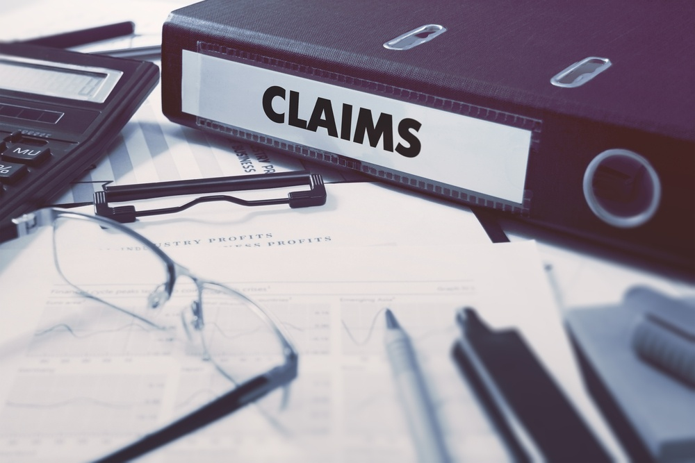 Claims - Ring Binder on Office Desktop with Office Supplies. Business Concept on Blurred Background. Toned Illustration.-1