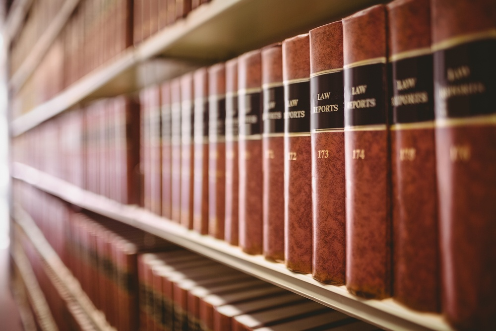 what is the Medicare statute of limitations? A shelf full of legal books.