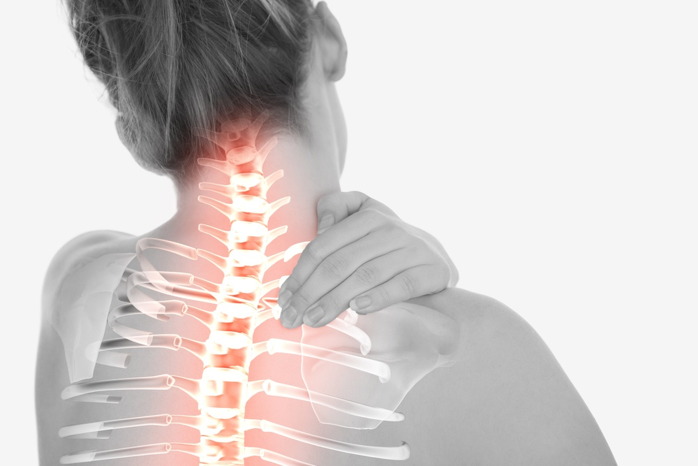 Digital composite of Highlighted spine of woman with neck pain-1.jpeg