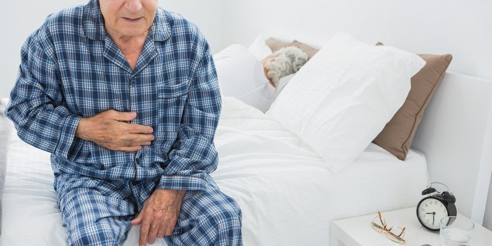 Elderly man suffering from stomach pain