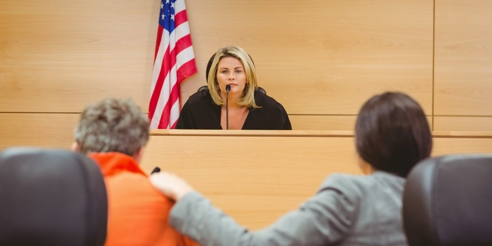 Judge and lawyer discussing the sentence for prisoner in the court room-853830-edited