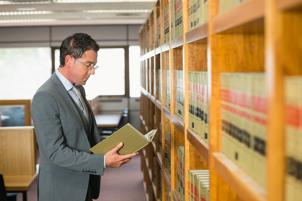 Lawyer reading book in the law library at the university-2