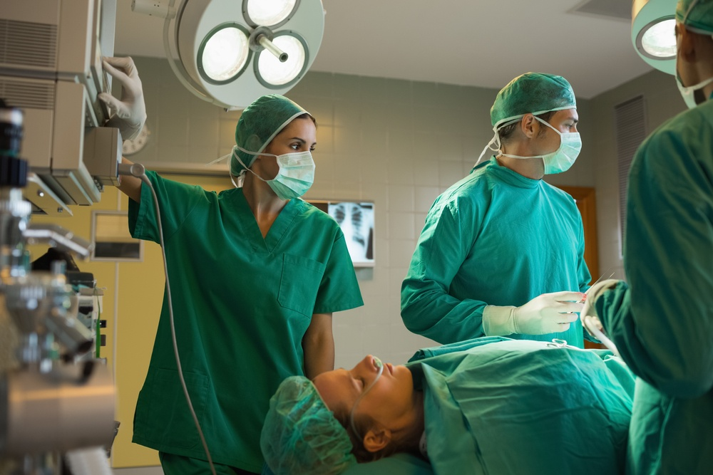 Surgeons working on a female patient in an operating theater