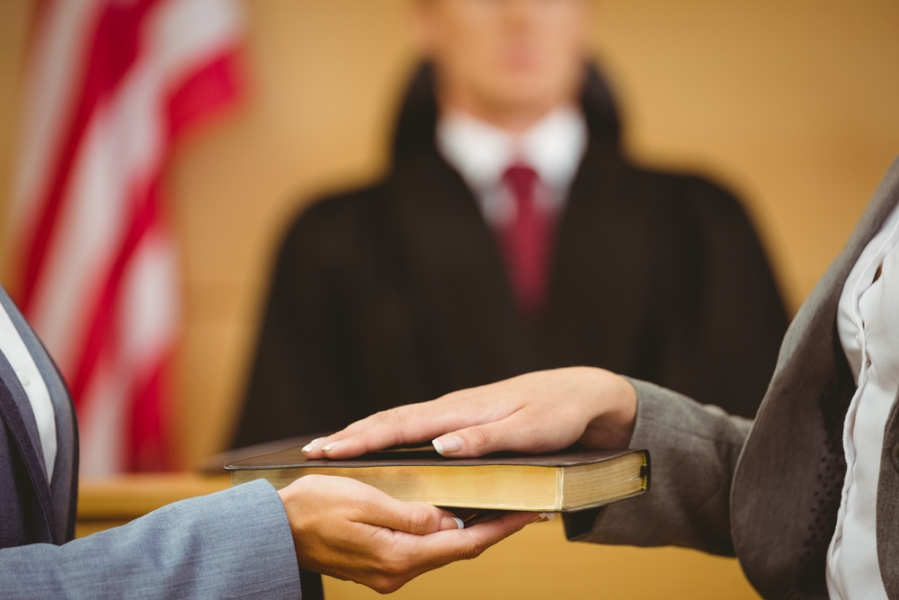 Witness swearing on the bible telling the truth in the court room-3