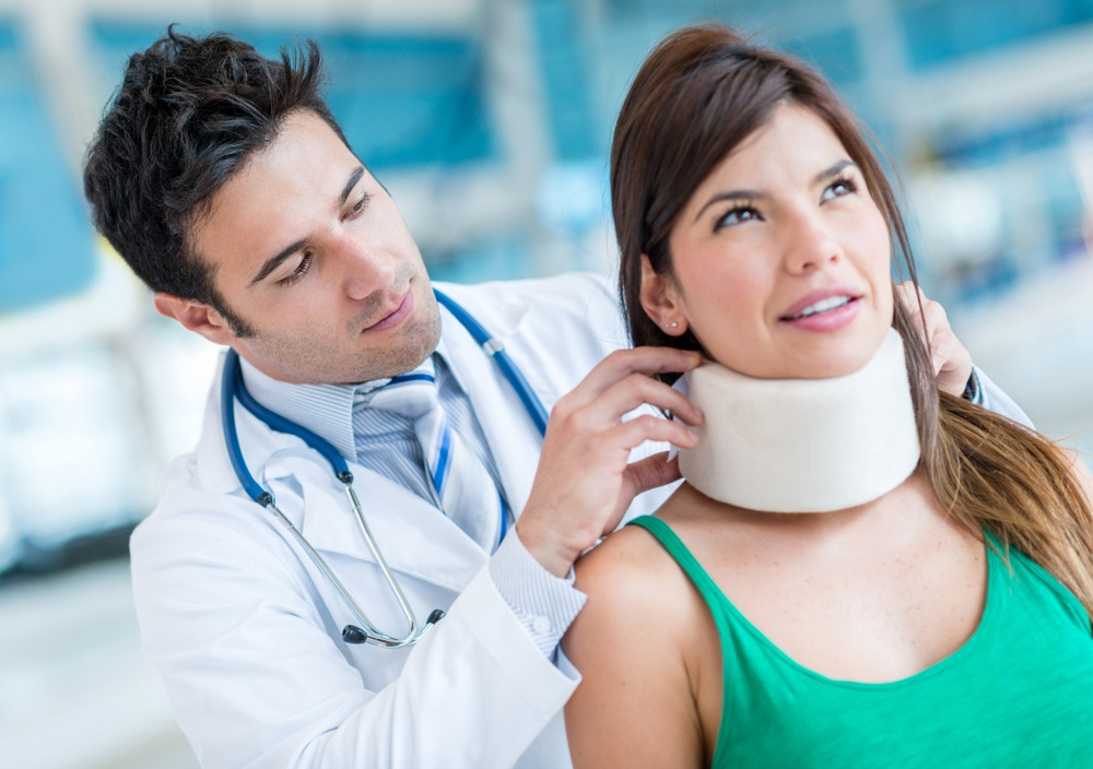 what to do in the event of an auto accident personal injury woman in neck brace with doctor