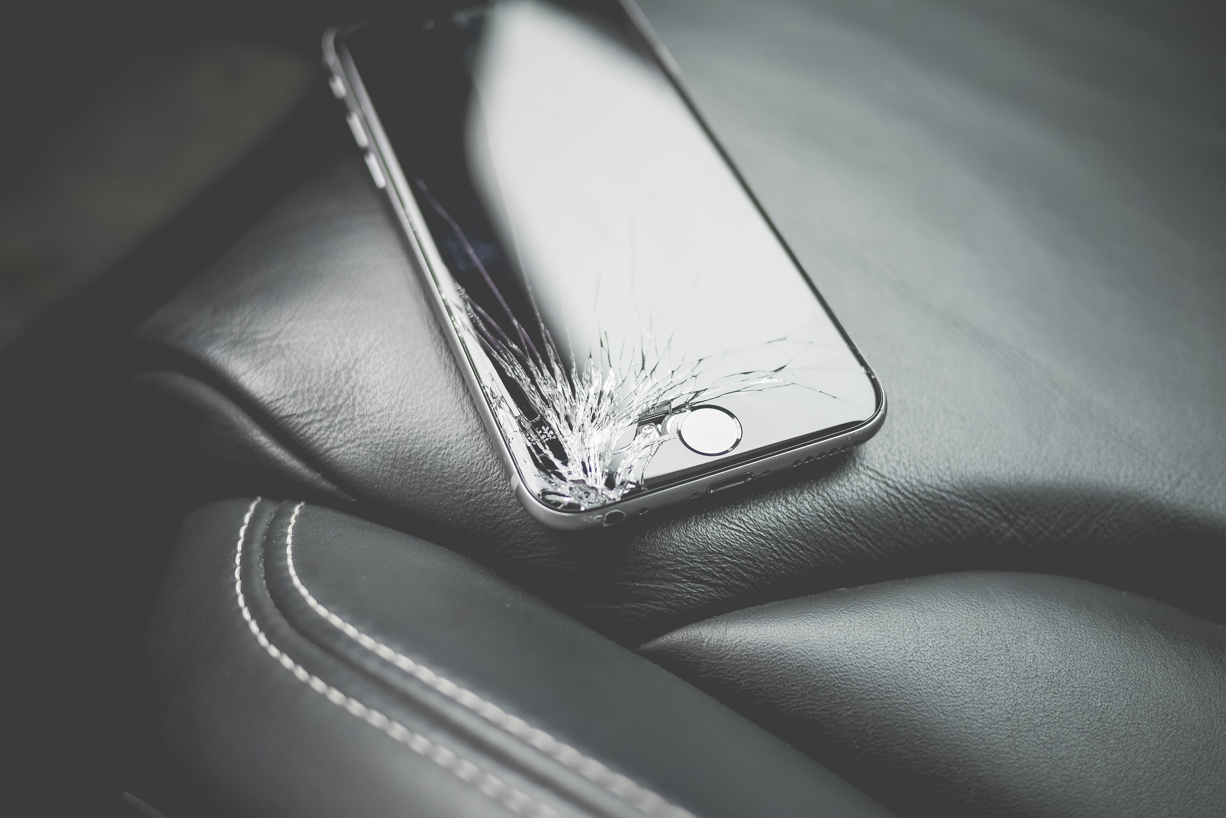 broken iphone on car seat