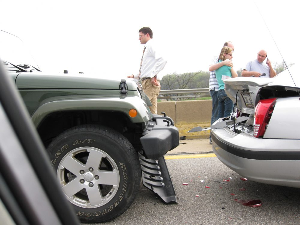 Car Accident With People Standing Around The Collision Sight