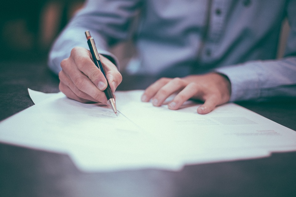 Man writing on important documents