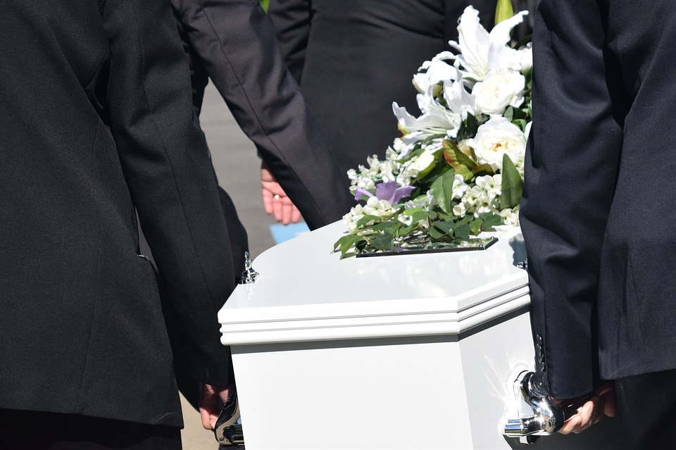 Pallbearers carrying a coffin