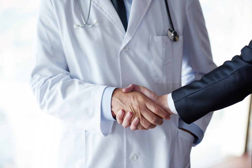 what is upcoding? Do I need a medicare fraud attorney? Doctor shaking a patient's hand