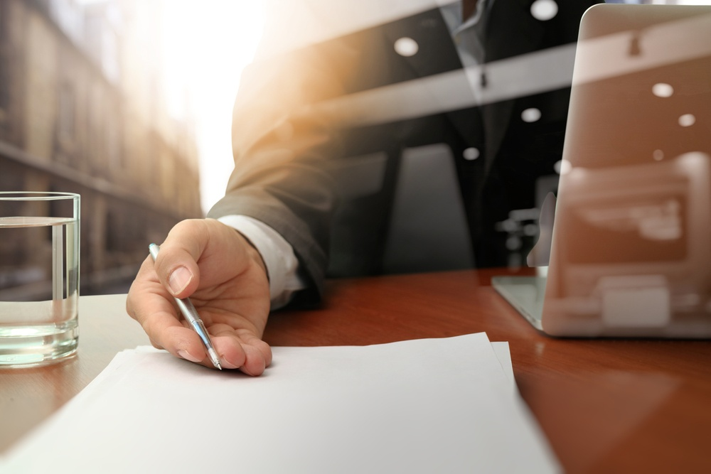 double exposure of businessman or salesman handing over a contract on wooden desk-2