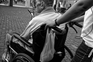 elderly man sat in wheelchair