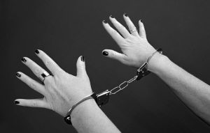handcuffs on woman's hands