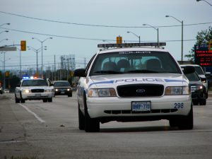 police cars on the road